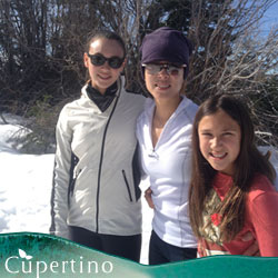 Dr. May and her two daughters cross country skiing